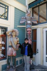 Joann in front of totem pole and Native American statue at Skagway.jpg