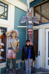 Joann and in front of a totem pole in Skagway.jpg