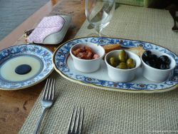 Olives and tomatos plate at La Cucina restaurant aboard the NCL Pearl.jpg