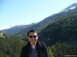 David with Skagway mountains and trees in the background.jpg