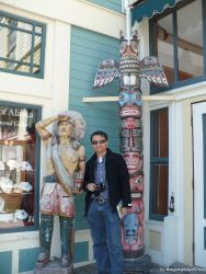 David next to Native American statue and totem pole in Skagway.jpg